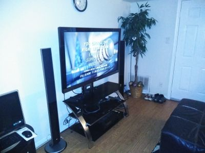 55inch Sony Bravia with stand and everything u see speakers and DVD player and amp receiver