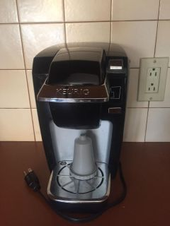 Keurig - Gently used. Comes with attachment to use bagged coffee instead of kcups.