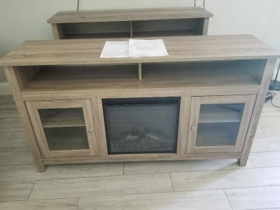 """TV Console up to 70"""" new with electric fireplace."""