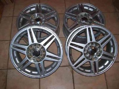 $100 4 ALUMINUM WHEELS (2 sets), 15 x 6.5 in., dual bolt pattern, 5 lug, 36 mm