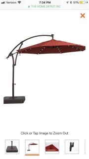 11 ft chili red outdoor umbrella with solar LED lights