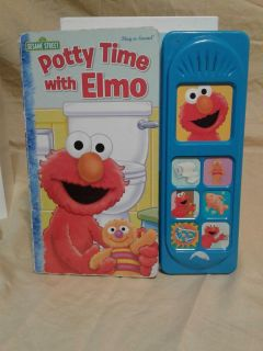 Potty time with Elmo book. Makes different sounds. Meet in Angleton.