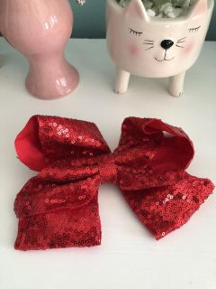 NWOT Red sequined 8 bow on alligator clip