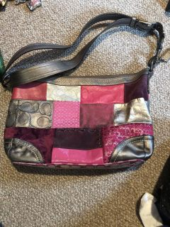 Authentic Coach purse, some worn spots on the suede squares, 5.00
