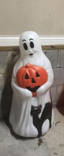 $1.00 Halloween outside Ghosts lights up