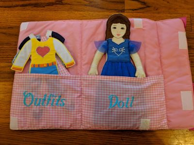 Press and Dress Doll. Comes with 5 outfits and carrying purse