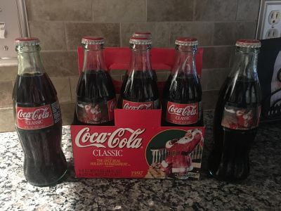 1997 Christmas Holiday edition 6 pack. Unopened collectible commemorative coke bottles.