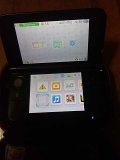 Nintendo 3ds xl with charger and case and 13 games