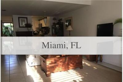 Dadeland Cove 2-story-town home with2 parking spaces in front of unit.