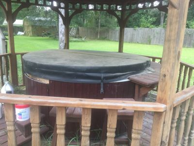 Hot tub ,seats 4 ,with cover, and steps call Alice at 281-455-4545