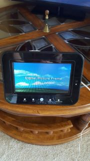 Digital picture frame. Takes simcard