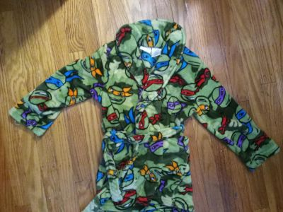 Super soft Ninja Turtles robe. Boys size (6/7). Can also fit 5T as well. Brand New never worn.