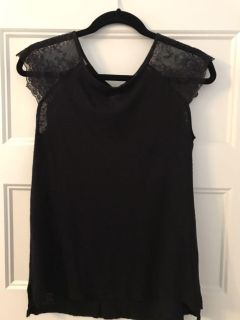 Black top with lace shoulders and classy button detail on back. Size M