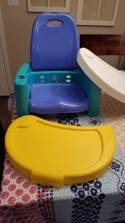 The First Years brand booster seat.