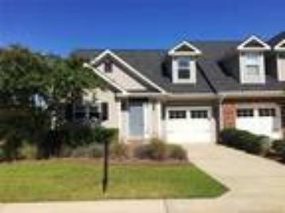 Located in the golf community of Kings Grant,...