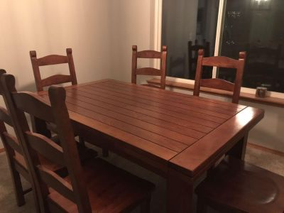 7 piece dining room set can seat 10-12 when both leaves are extended. Leaves slide into the table so there is no storing. EUC