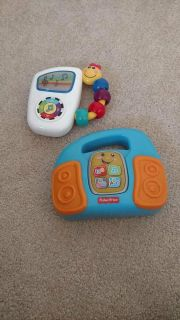 Musical toys. Fisher price radio and baby Einstein music player