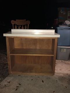 Wooden cabinet with shelf