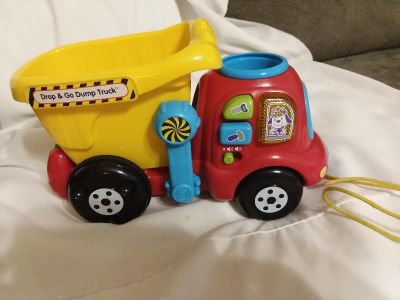VTech Dump and Go Truck Learning Toy comes with 3 balls very good used condition