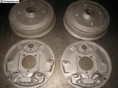Front brake drums with backing plates