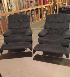 Two dark green recliners