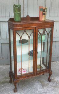 Antique claw foot curio cabinet