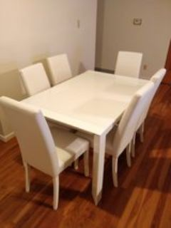 Glass table and 6 leather chairs