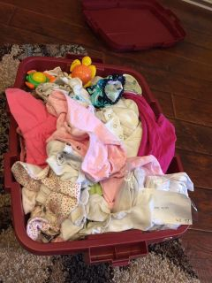 Lot of baby girl clothes.