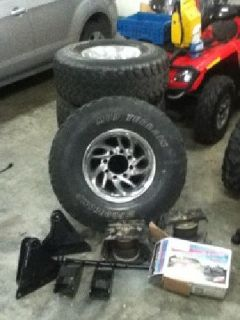 $1,000 Ford powerstroke fabtech lift kit, rims, and tires
