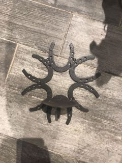 Horse shoe candle sconce