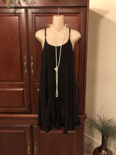 15.00 small Entro gorgeous boho chic boutique dress. It s a worn blackish color/ adjustable spaghetti straps. Add a jean jacket