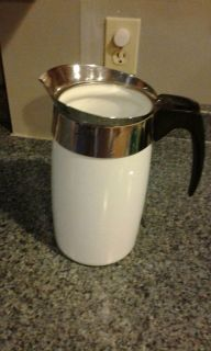 Corning wear pitcher, heavy, has cup lines on inside.