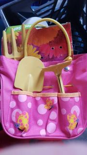 Little girl garden bag with tools