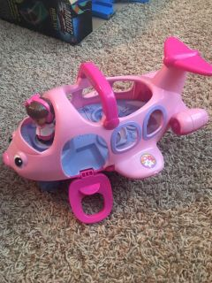 Pink airplane with figure