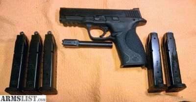 For Sale: Smith & Wesson M&P -- 40 Cal w/9mm Barrell and Mags