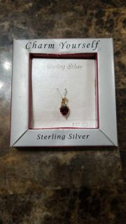 Garnet colored stone heart gold over sterling charm.