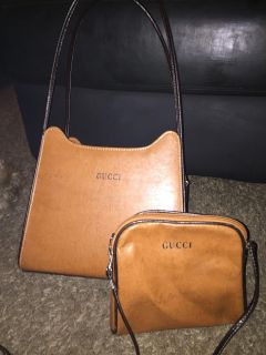 Brown leather purse with makeup bag