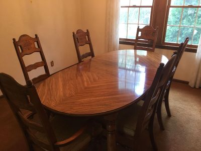 Oval dining room table and 6 upholstered chairs.