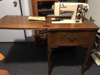 Universal sewing machine with wood cabinet