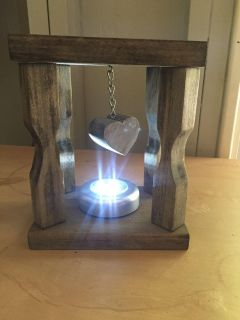 Wood lantern with light and hanging heart