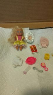 Vintage barbie baby with many acessories as pictured.