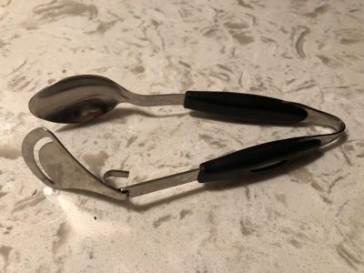 Spoon with auto scraper. Squeeze handles to remove whatever is on the spoon.