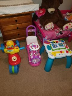 2 riding toys and a table toy.