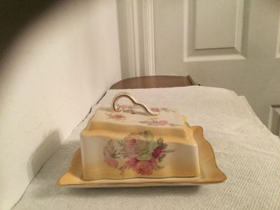 Gorgeous unique antique butter dish.made in England .stamped underneath.super condition.never been used.no chips.no cracks.