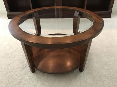 Bassett Furniture round hardwood and glass coffee table