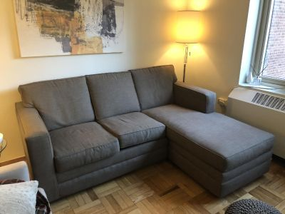 Queen sleeper sofa with alternating chaise