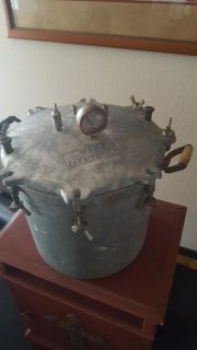 Antique pressure cooker with wooden handles