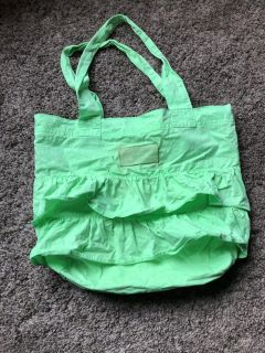 Little Girls neon green RUUM tote. Some spots.