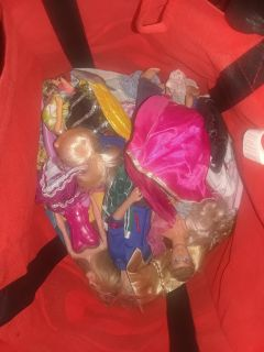bag of barbies and clothes