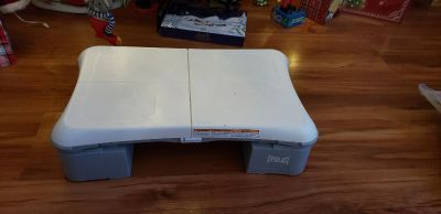 ONLY USED ONCE CHRISTMAS GIFT. WII FIT BOARD AND ACCESSORIES